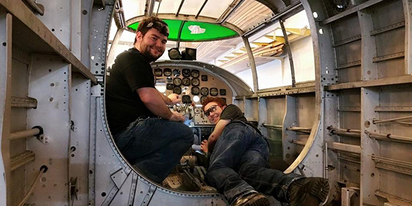 Anthony and Logan work in the cockpit.